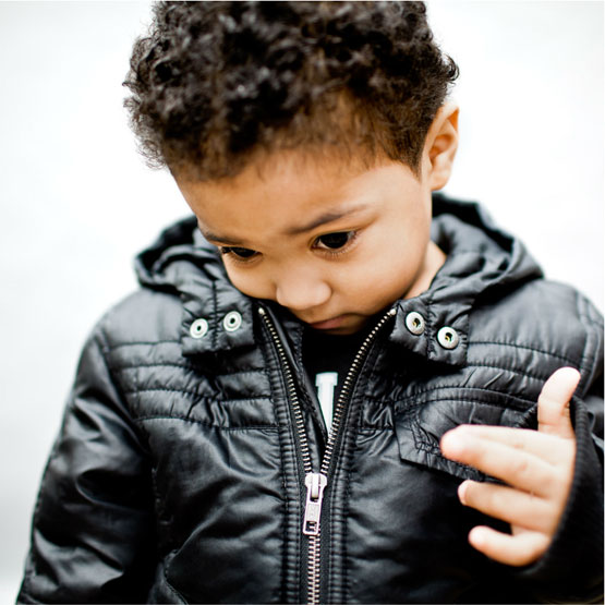 An image of a young boy at GLIDE San Fransisco by Lisa Wiseman.