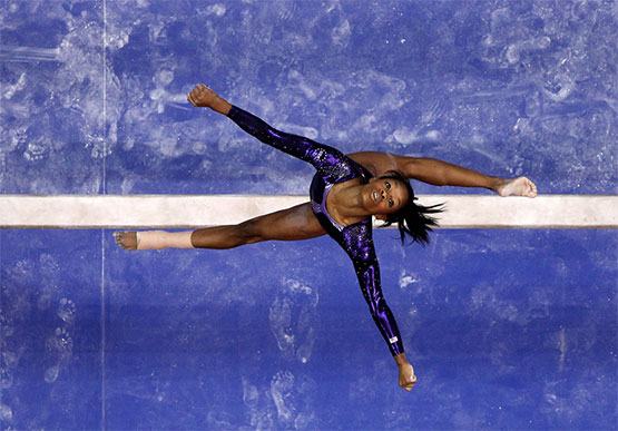 Gabrielle Douglas on the beam at the 2012 Olympics in London. ©Ezra Shaw/Getty Images