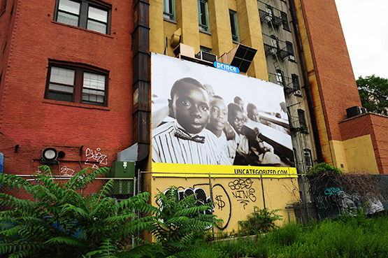 © Chi Modu. An image of children at a school in Eastern Nigeria on a billboard in Manhattan's SoHo neighborhood.