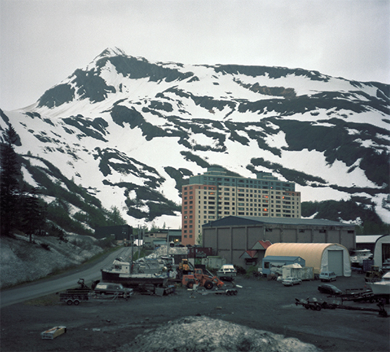 The Begich Towers after midnight, Whittier, Alaska, 2012.. Photograph by Jen Kinney, winner of the 2013 Lange-Taylor Prize.