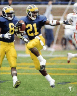 Desmond Howard's iconic Heisman Trophy pose. Shot by Brian Masck. Now owned by Desmond Howard