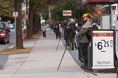 Photographers line up November 1 to photograph Tryon Street simultaneously on signal. ©Rodney Nichols