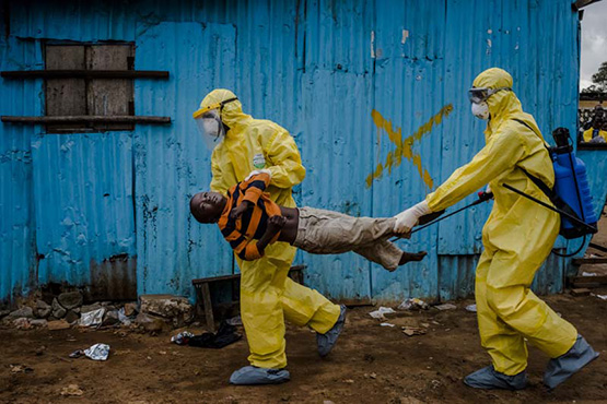 Ebola victim James Dorbor, 8, is rushed into a treatment center in Monrovia, Liberia. He died a short time later. ©Daniel Berehulak/Getty Images