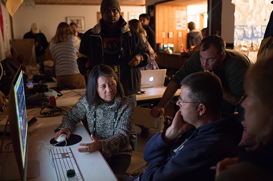National Geographic Senior Photo Editor Elizabeth Krist during an editing session at the 2014 Eddie Adams Workshop. Photo © Nancy Borowick