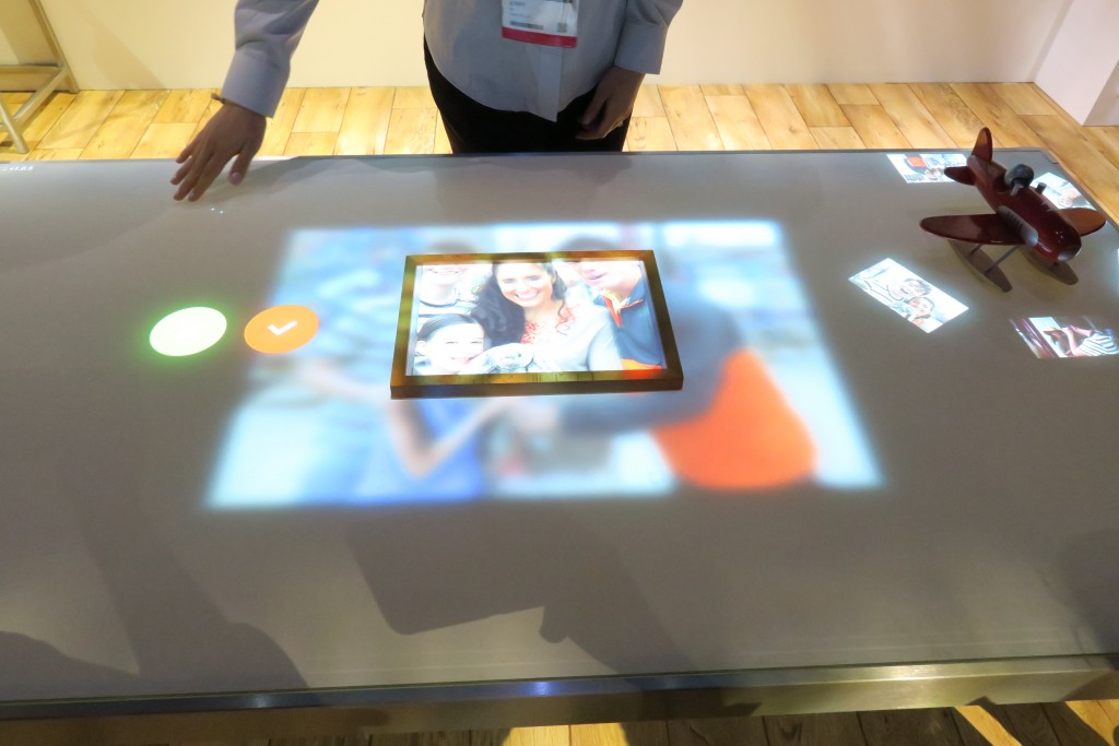 Canon's Smart Home concept. The smart table can use a picture frame to crop digital images.