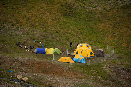 Photographer Paul Colangelo's camp, with an electric fence protecting his kitchen and supply tents. Todagin Mountain, norther British Columbia. ©Paul Colangelo