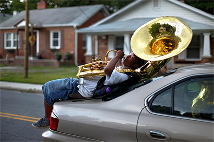Marzell Williamson plays the tuba, by Jerry Wolford, winner of Photojournalist of the Year honors at last year's Best of Photojournalism competition. ©News & Record/Jerry Wolford Photojournalism 2015 Ph