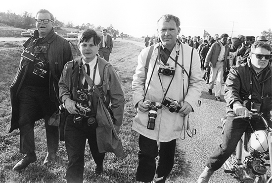 Bob Adelman (left), Steve Shapiro, Charles Moore, and an unidentified LIFE magazine film courier at the Selma march in 1965.