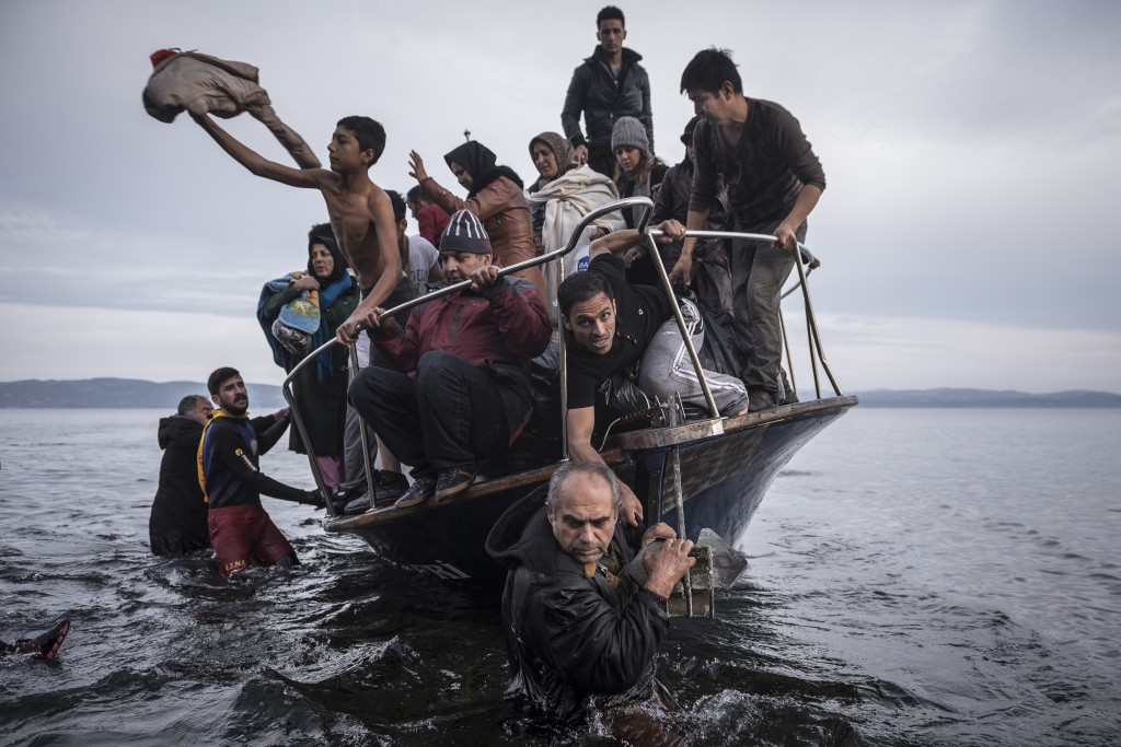 Migrants arrive by Turkish cruise boat near village of Skala, Lesbos island Greece, Monday November, 16, 2015. The Turkish boat owner delivered some 150 persons to the Greek coast and tried to escape back to Turkey, he was arrested later in Turkish waters. Photo © Sergey Ponomarev for The New York Times.