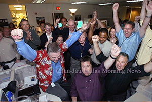 "William Snyder, in his ""lucky"" Pulitzer shirt, celebrates in 2006 with the Dallas Morning News photo team that won the prize for Breaking News Photography. ©Mei-Chun Jau/Dallas Morning News"